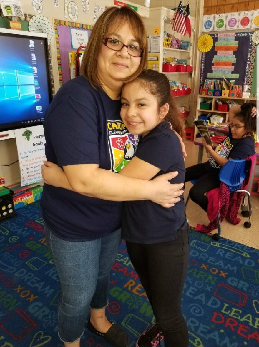 Marissa Alvarado and her daughter Allisson pose for a photo at Allisson's new school, Carvajal. Allisson attended Rodriguez Elementary before it closed at the end of the 2018-2019 school year.