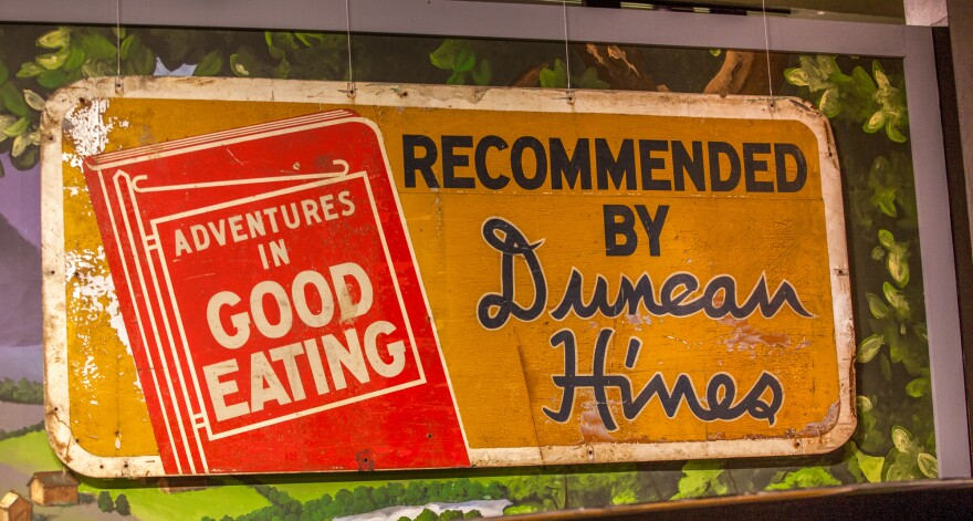 A roadside sign advertising Duncan Hines' <em>Adventures in Good Eating</em> is on display at the Kentucky Museum at Western Kentucky University.