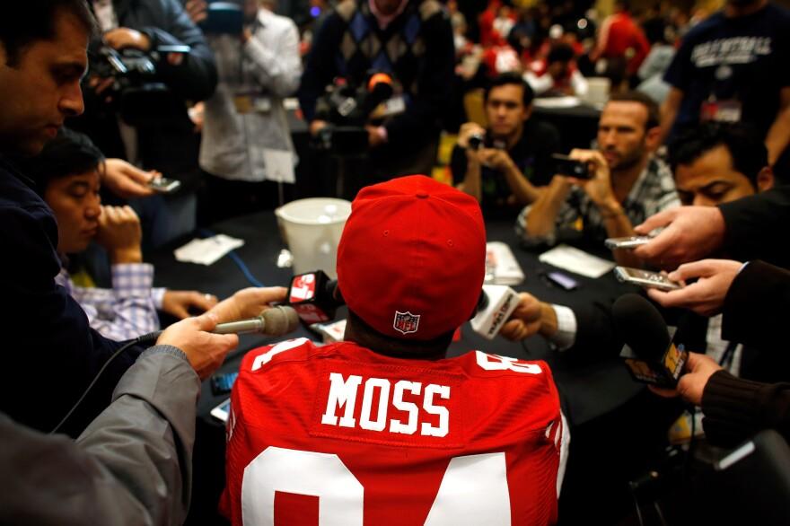 Randy Moss of the San Francisco 49ers addresses the media on Jan. 31.