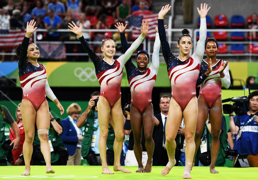 (Left to right) Laurie Hernandez, Madison Kocian, Simone Biles, Aly Raisman and Gabby Douglas celebrate after winning the winning the gold medal in women's gymnastics on Tuesday.