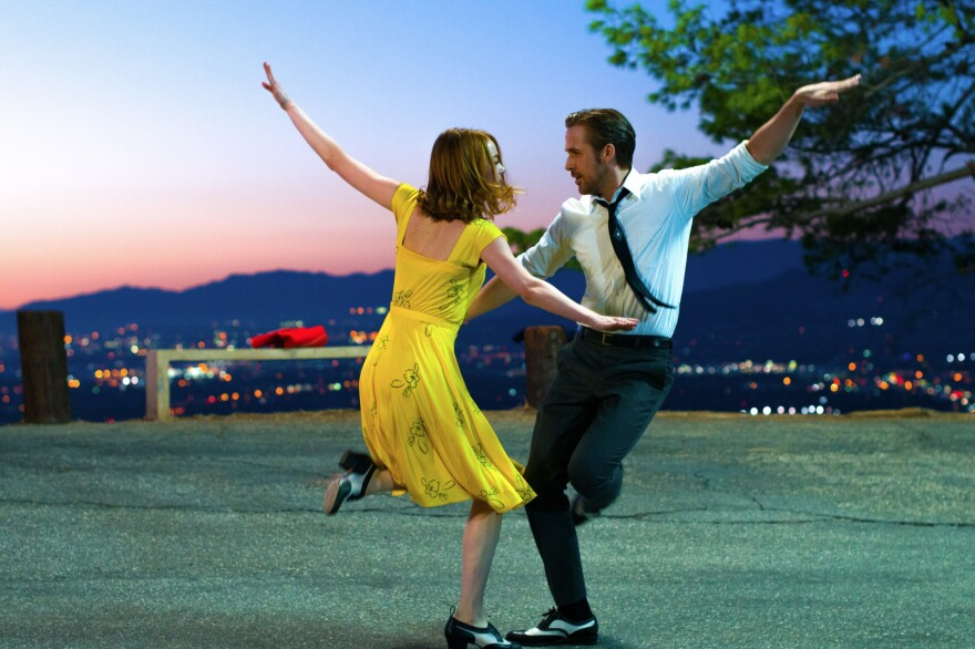 Emma Stone and Ryan Gosling dance in the musical, <em>La La Land, </em>critic David Edelstein's pick for the best film of the year.