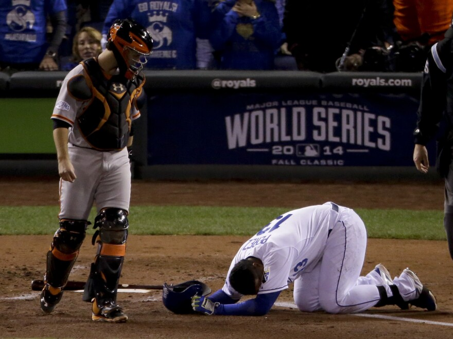 Kansas City catcher Salvador Perez lies on the ground after being hit by a pitch from San Francisco's Tim Hudson in the second inning of Game 7 on Wednesday.