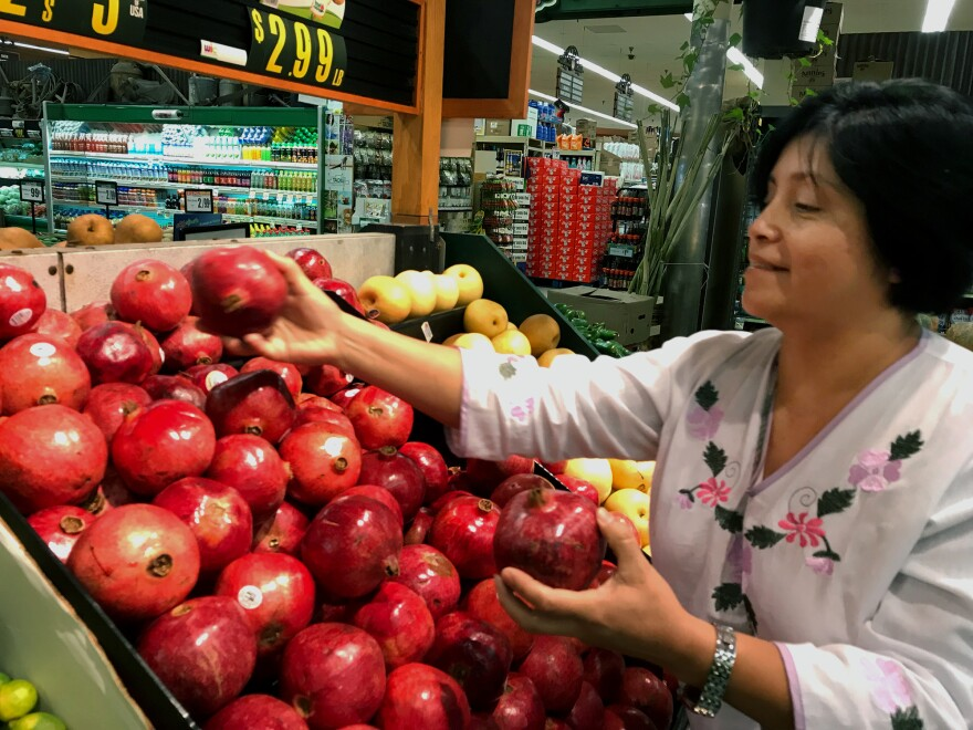 Rebeca Gonzalez says she can now afford to buy pomegranates for her family in Garden Grove, Calif., because of the extra money she receives through Más Fresco, a food stamp incentive program for purchasing produce.