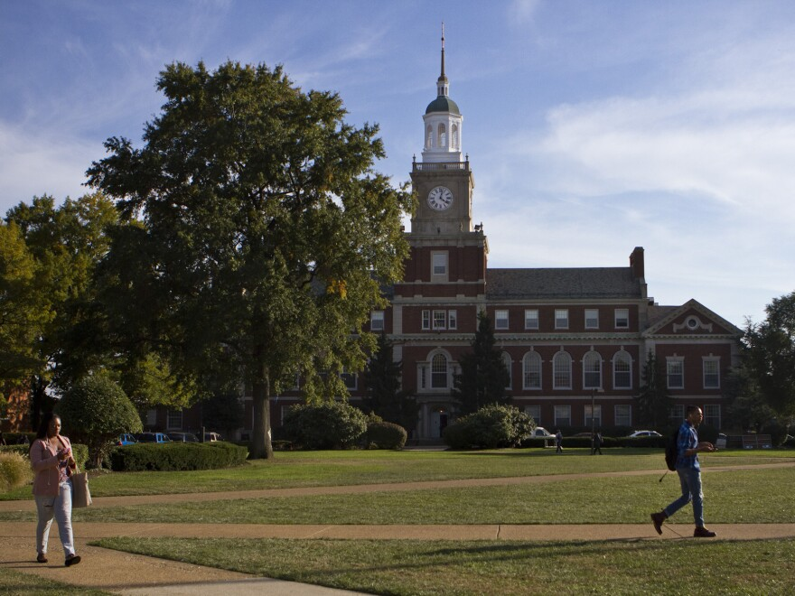 Students walk by Founders Library on Howard University campus in Washington, D.C.
