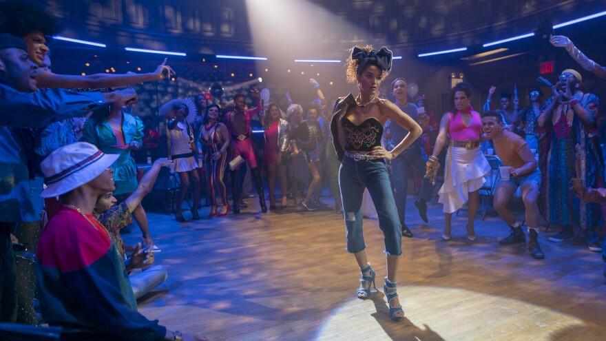 Indya Moore walks the runway as Angel in the FX series <em>Pose.</em>