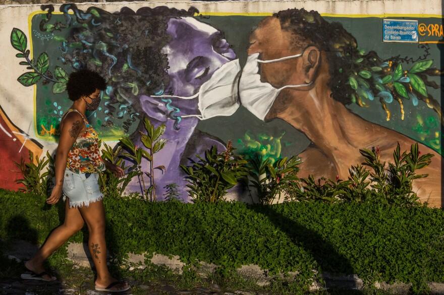 A woman walks in the street of Salvador, Brazil.