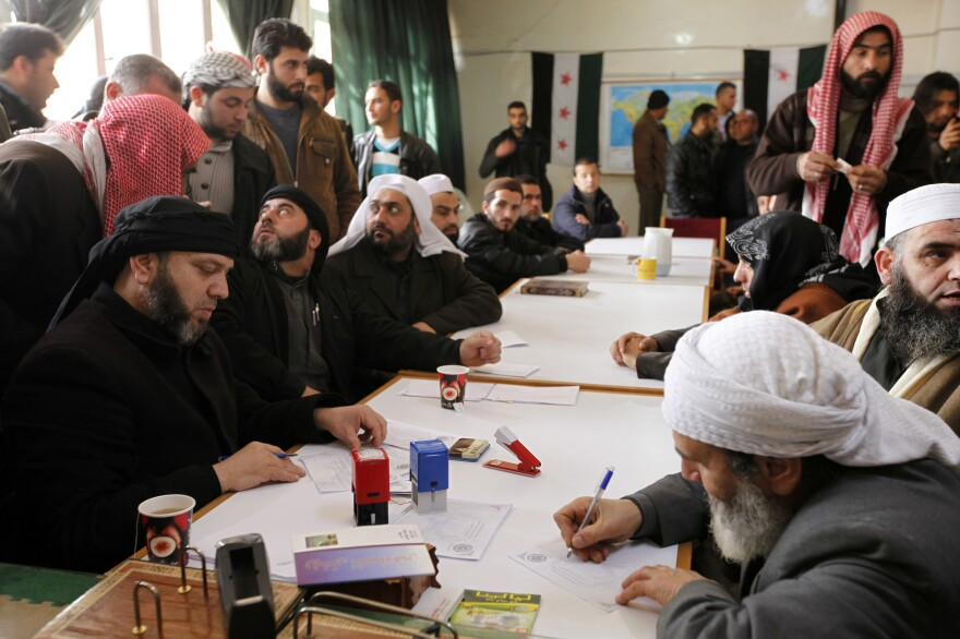 """An Islamist rebel group in Aleppo called """"the Authority for the Promotion of Virtue and Supporting the Oppressed"""" reviews applications for aid on Feb. 25. In addition to handing out aid, the Islamist group says it is carrying out civilian administration in parts of Aleppo."""