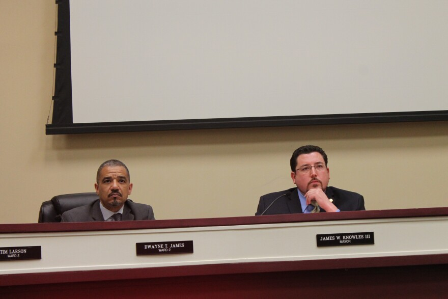 Ferguson Mayor James Knowles III, right, and Ferguson Councilman Dwayne James sit in on Tuesday's meeting of the Ferguson City Council.