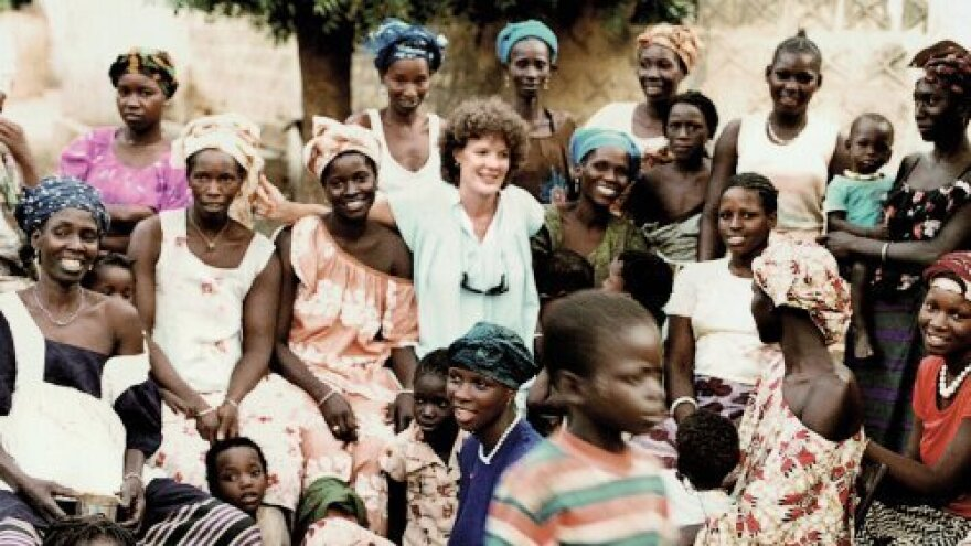 Women's health activist Molly Melching poses with some of the women she worked with and taught in Senegal. Over a period of 20 years, Melching's activism helped drastically reduce female genital cutting in a region of the West African nation.