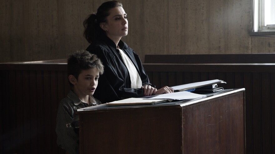 <em></em>In <em>Capernaum</em>, Zain (Zain Al Rafeea) takes the stand to sue his parents. In a cameo appearance, his lawyer is played by the film's director, Nadine Labaki.