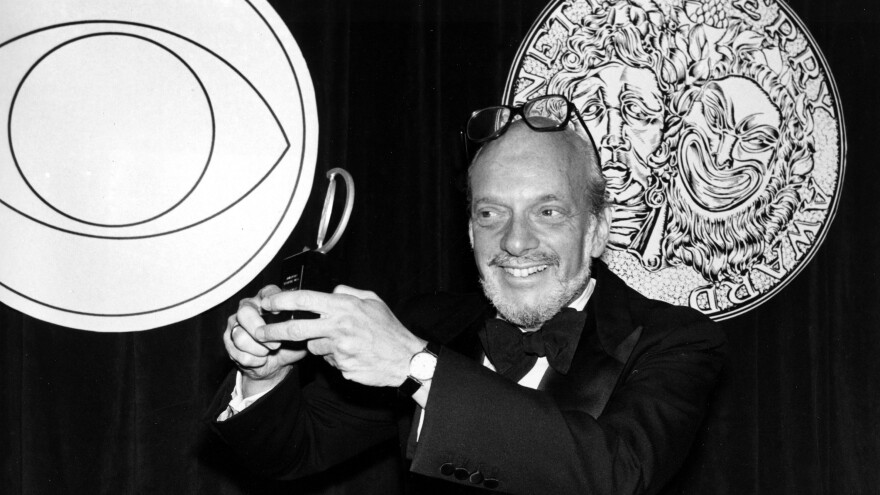 Harold Prince poses with his Tony Award for best direction of a musical in 1980. He earned the honor for his work on <em>Evita.</em>