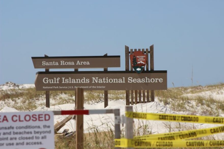 Gulf Islands National Seashore sign on the beach