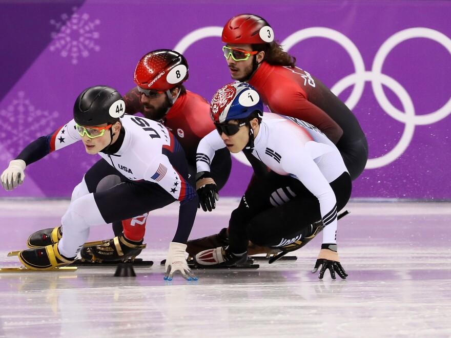 John-Henry Krueger of the United States (left), Yira Seo of Korea, Charles Hamelin of Canada and Samuel Girard of Canada compete in the short track 1,000-meter semifinals on Feb. 17. Krueger won silver.