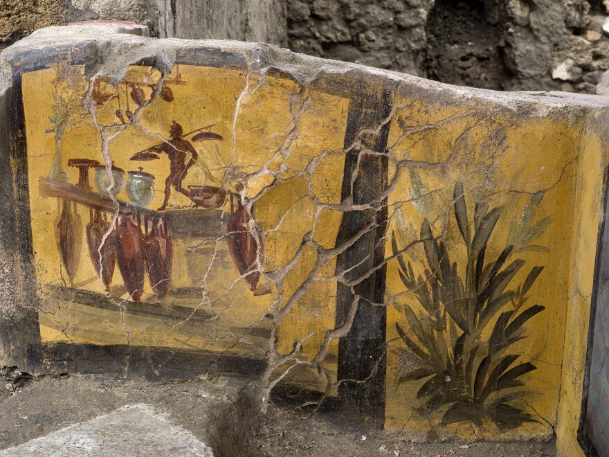 The thermopolium features several paintings like this one in the Pompeii archeological park.