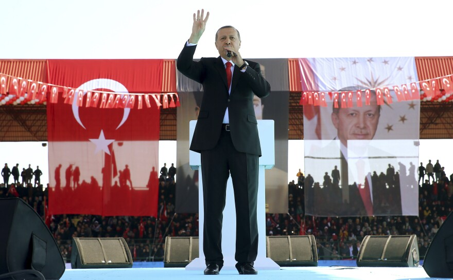 Turkey's President Recep Tayyip Erdogan talks at a ceremony Friday commemorating the 101st anniversary of the Battle of Gallipoli in Canakkale, Turkey, Friday. Turkey and the European Union annouced an agreement Friday to deal with Syrian refugees. But Turkey-EU relations have been strained on a number of issues.