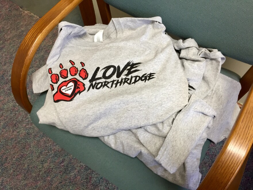 T-shirts in Spaugy's office. The volunteer effort continues in Harrison Township.