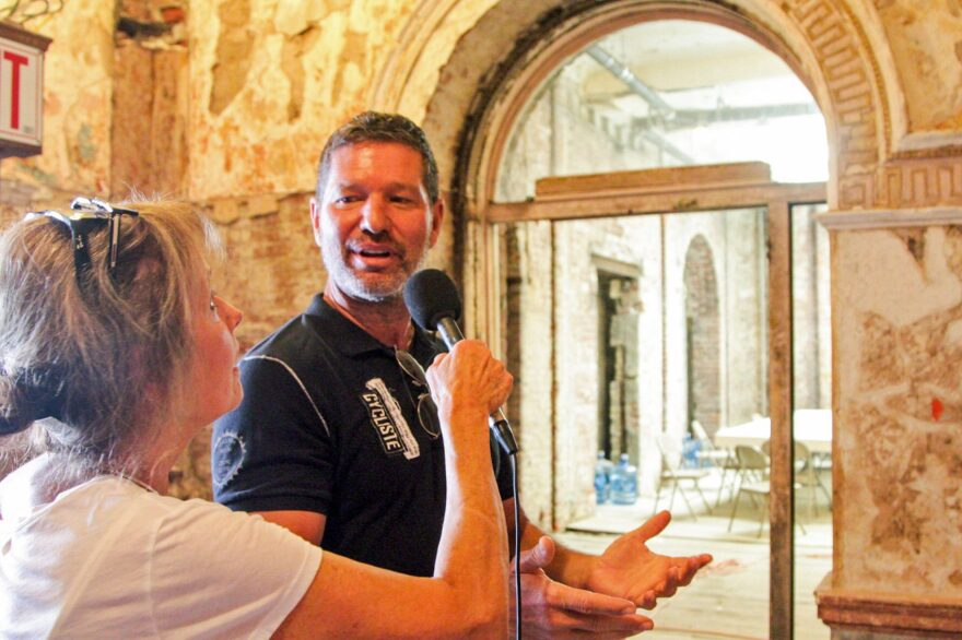 Developer Eric Blumenthal takes Here & Now's Robin Young on a tour of the Divine Lorraine Hotel. (Dean Russell/Here & Now)