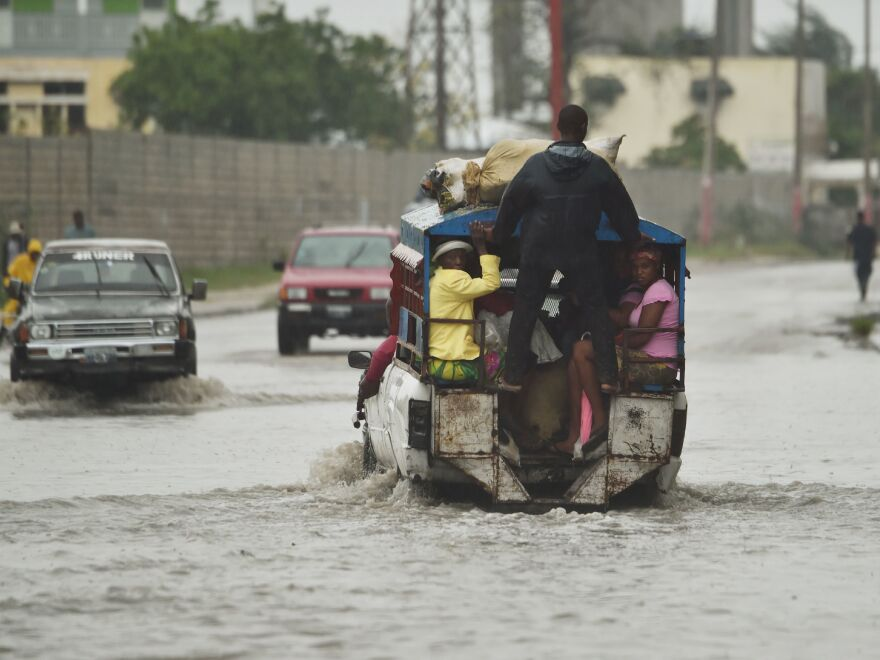 Streets in Haiti's capital, Port-au-Prince, were inundated Tuesday after Hurricane Matthew made landfall in the country's southwest.