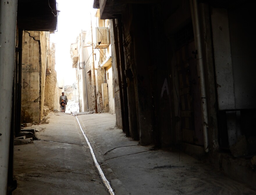 An alleyway in a street on Mosul's Old City. Some of the streets have been cleared of explosives and rubble from collapsed houses, which prevented people from reaching their homes. Other streets remain covered in debris.