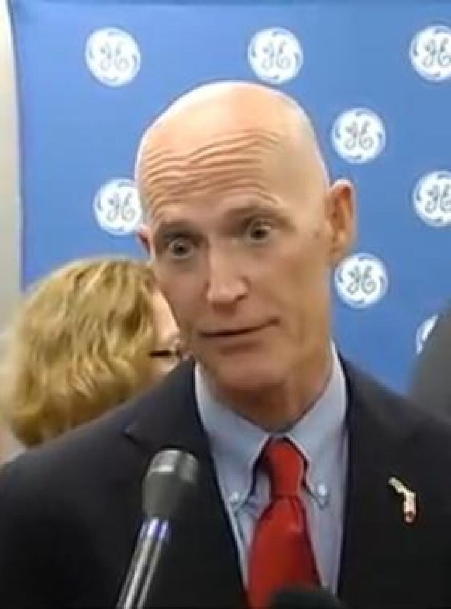 Gov. Scott speaking to reporters last week, following a Jacksonville Jobs announcement.