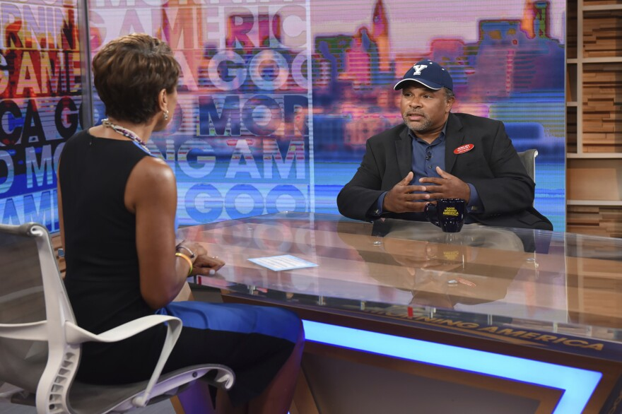 """This image released by ABC shows co-host Robin Roberts, left, with """"The Cosby Show"""" actor Geoffrey Owens during an interview on """"Good Morning America,"""" Tuesday, Sept. 4, 2018, in New York. Owens says he's thankful for the support he has received since photos of him working a regular job at a grocery store showed up on news sites. He said on ABC's """"Good Morning America"""" that he did feel some people were trying to job shame him. But he stressed that """"every job is worthwhile and valuable."""" (Paula Lobo/ABC via AP)"""