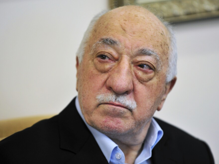 Cleric Fethullah Gulen spoke to reporters at his compound in Saylorsburg, Pa. His case was connected to new charges unveiled on Monday against associates of Michael Flynn.