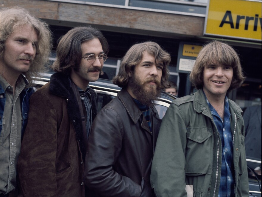 The original lineup of Creedence Clearwater Revival, at London's Heathrow Airport. L-R: Tom Fogerty, Stu Cook, Doug Clifford, John Fogerty.