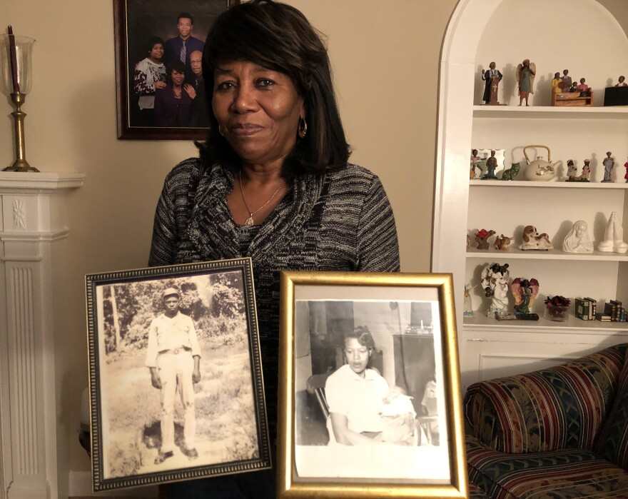 Deloris Melton Gresham in her home in Drew, Miss., holding photographs of her parents Clinton and Beulah Melton.