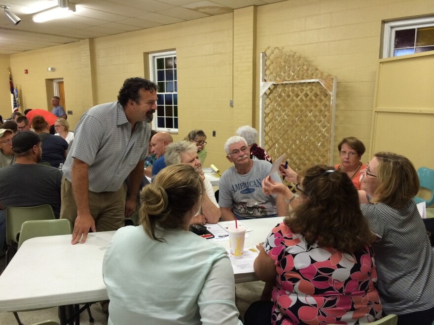 Community Improvement Coach Eric Pories interacts with a team at Monday night's workshop
