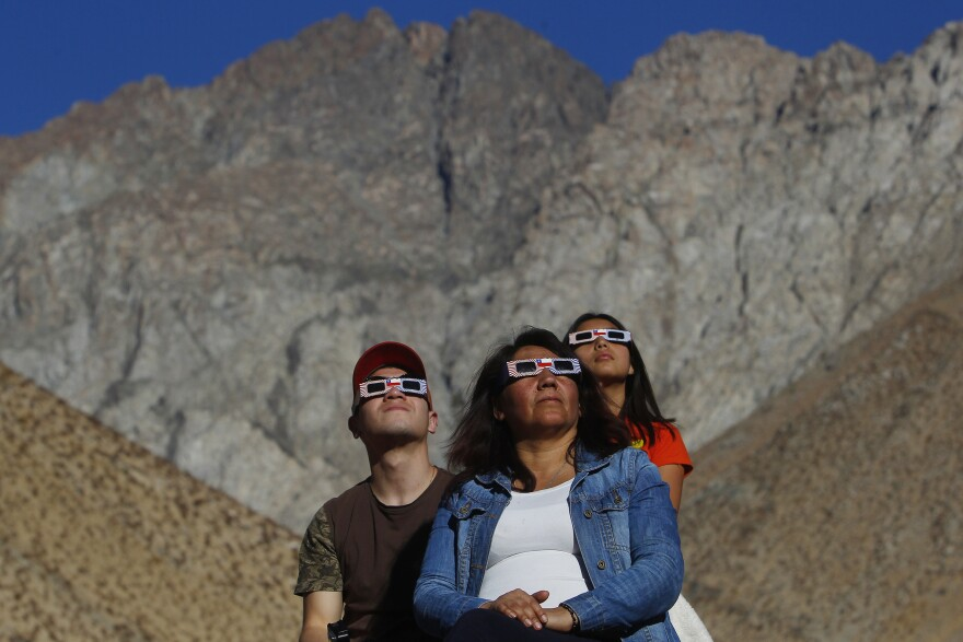 Chileans in Paiguano watch the sky prior to the solar eclipse. Thousands of tourists arrived at the small town of about 1,000 inhabitants in the Elqui Valley.