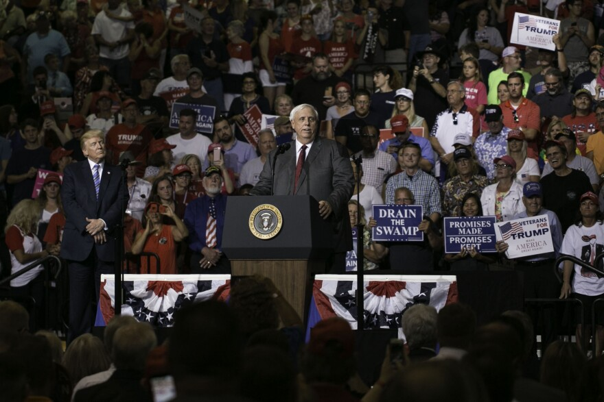 West Virginia Gov. Jim Justice takes the podium during a campaign rally for President Donlad J. Trump Thursday, Aug. 3, 2017, in Huntington, W.Va.
