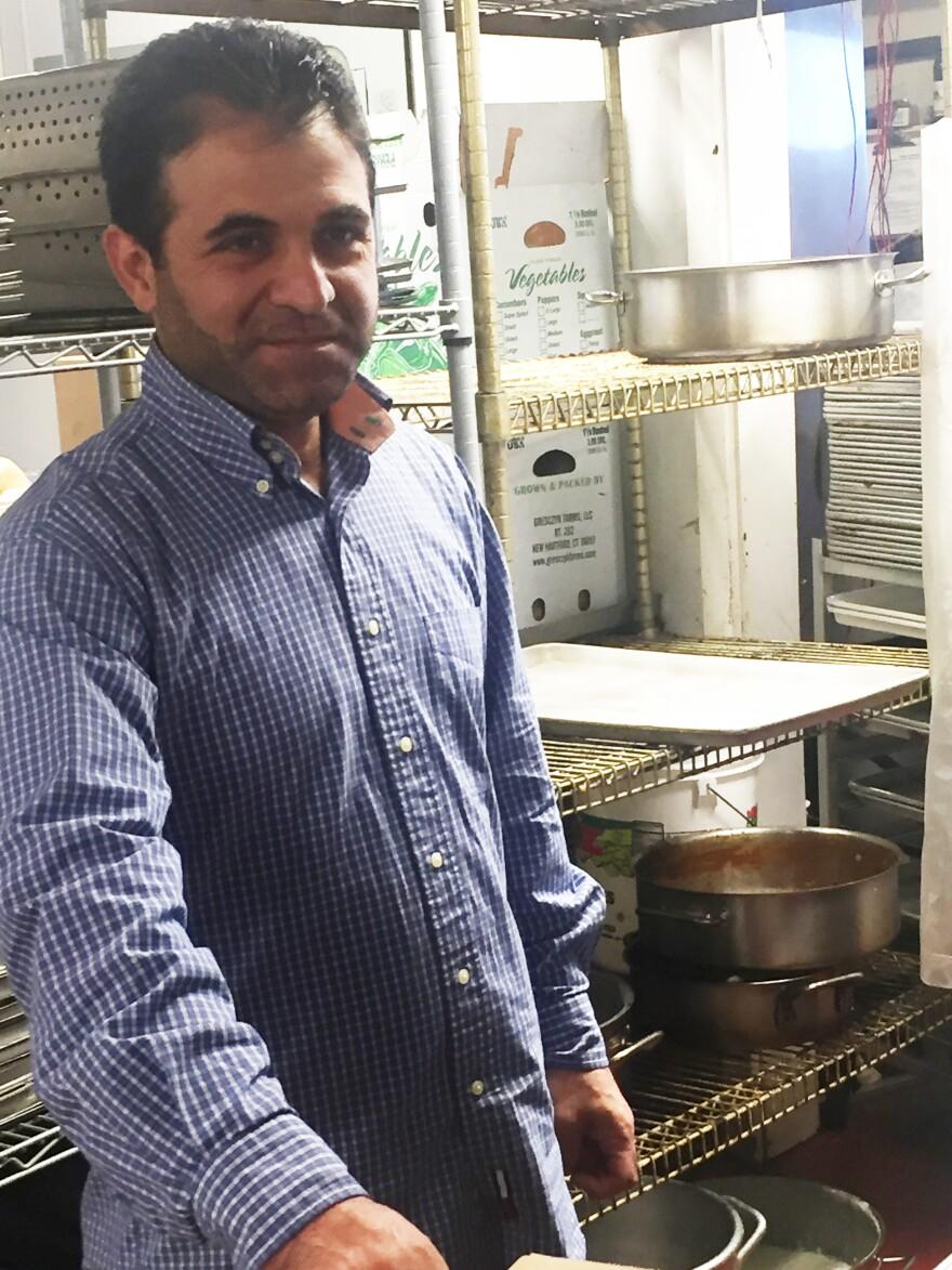 Syrian refugee Hani Hamou works as a dishwasher at the Fresh Salt restaurant in Old Saybrook, Conn.