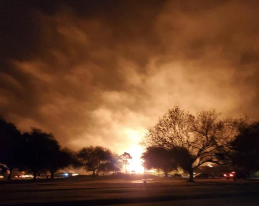 A fire burns at a chemical plant in Port Neches