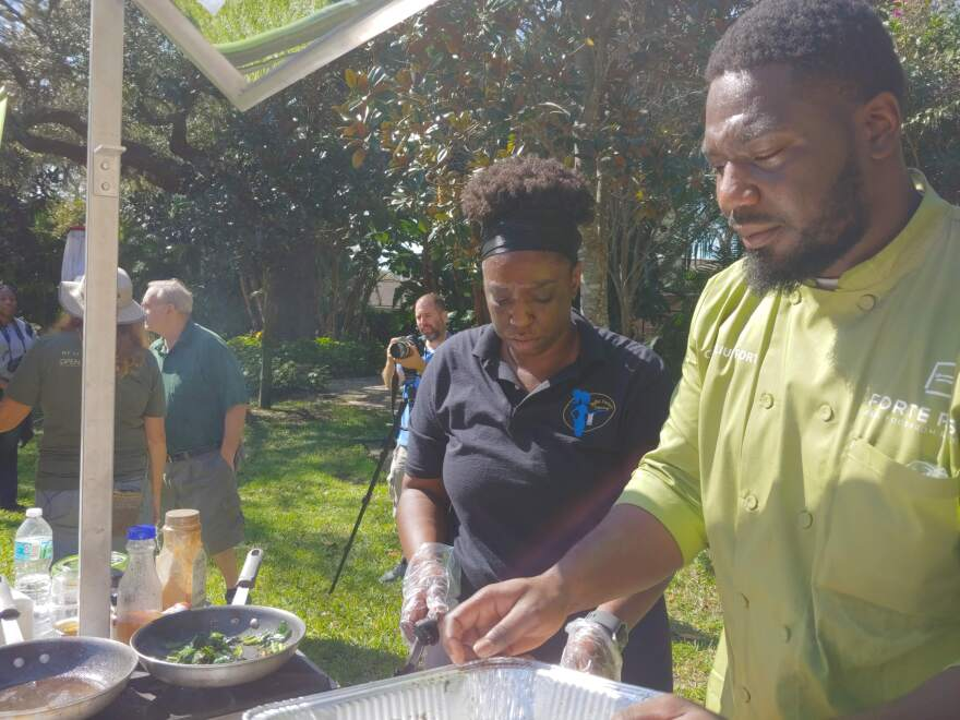 Chef Julius Forte prepares collard greens at the second annual Collard Greens Festival in St. Petersburg.