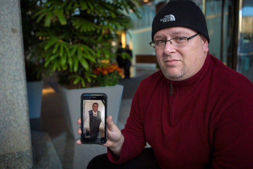 Anthony Salemi, of Everett, Mass., holds a photo of his brother Joe, who died from an overdose of fentanyl-laced heroin earlier this year.