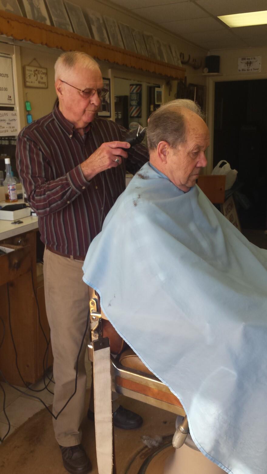 Ted Sessler's barber shop sits in the center of the village of Jamestown.