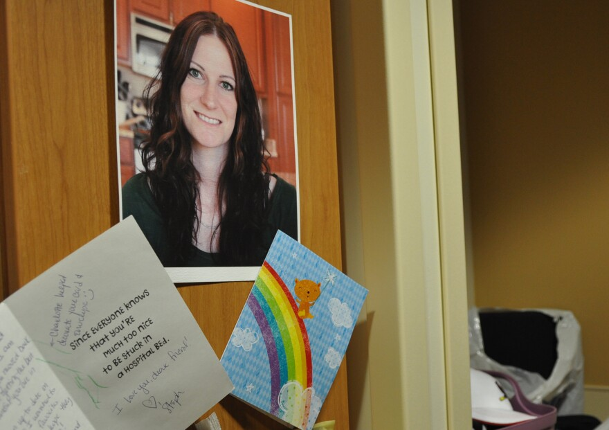 Cards from friends and family are taped next to an older photo of Tara Hegger, 32. Hegger was paralyzed from the waist down two years ago, after an operation to remove a tumor in her spine.