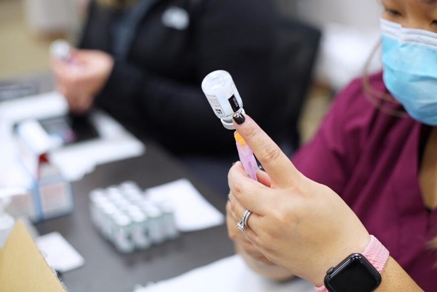 A nurse prepares Moderna vaccination at Columbus shot clinic