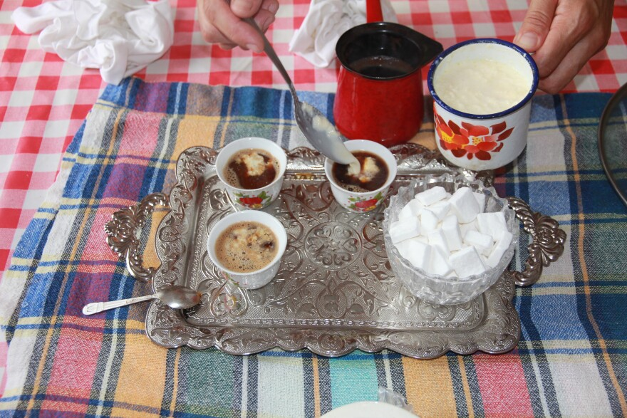 This tray shows a traditional way of serving Bosnian coffee with kajmak, a soft cheese made from fresh milk from a neighbor's cow.