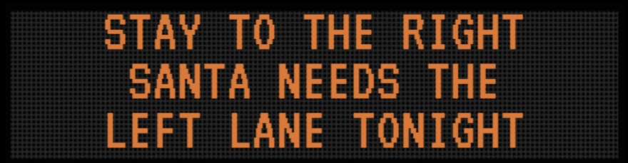 photo of a road sign telling drivers to stay in the right lane because Santa needs the left