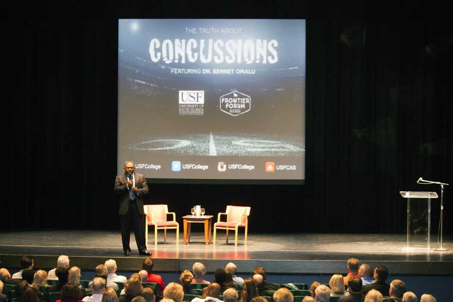 Dr. Bennet Omalu speaks to an audience at the Straz Center in Tampa ahead of the premiere of a movie based on his work.