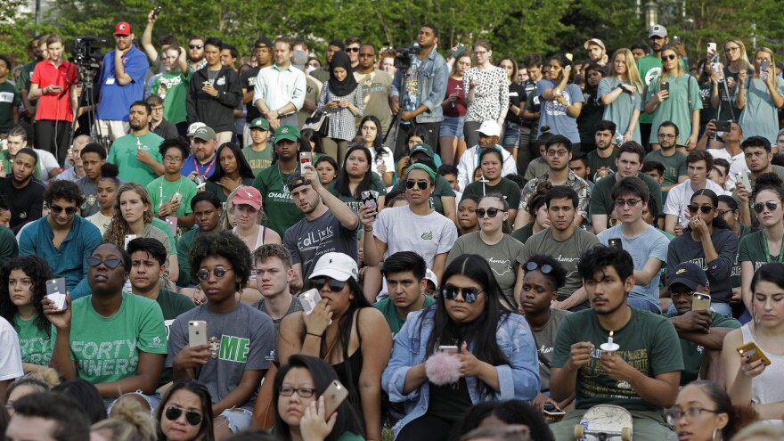 Students attend a vigil at the University of North Carolina's Charlotte campus to honor the victims of Tuesday's shooting.