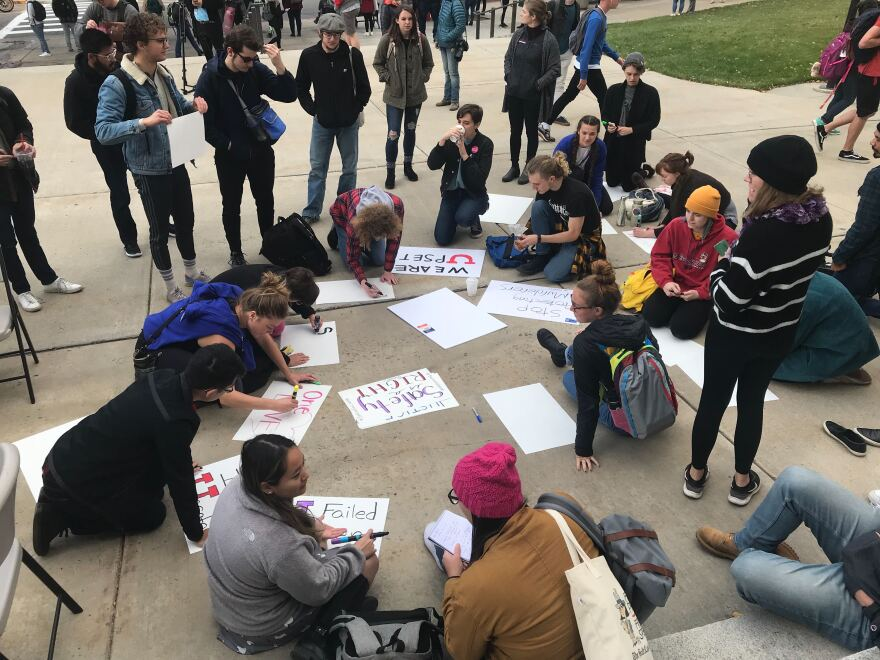 Photo of University of Utah students making posters.