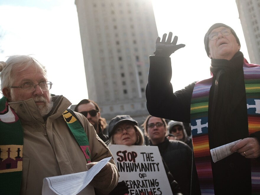 Dozens of clergy members, immigration activists and others participate in a protest against the imprisonment and potential deportation of an immigration activist. Religious liberals are becoming increasingly outspoken in their opposition to many Trump administration policies.
