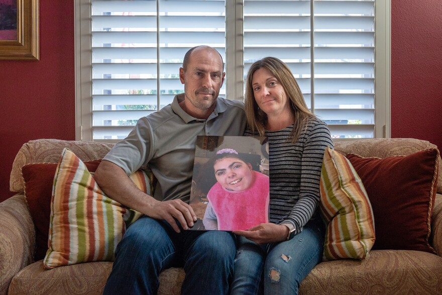 Bobby and Tara Dilliplaine hold a photo of daughter Brooke, who suffered complications when she was given medication she was allergic to. (She later died of causes unrelated to the EHR issue.)
