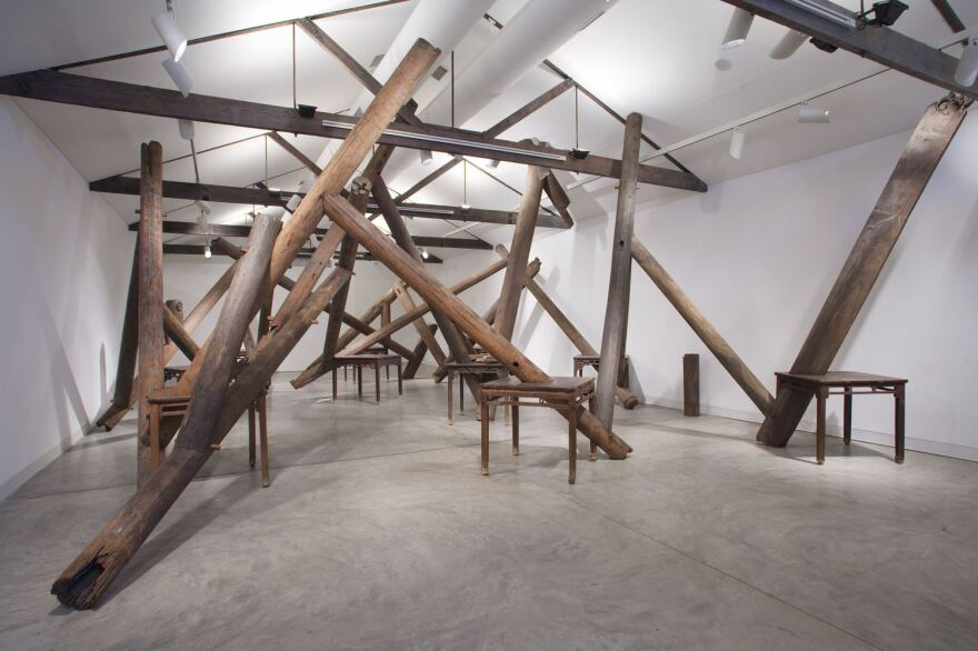 This piece called Through, 2007-2008, employs tables, beams and pillars from dismantled temples of the Qing Dynasty.