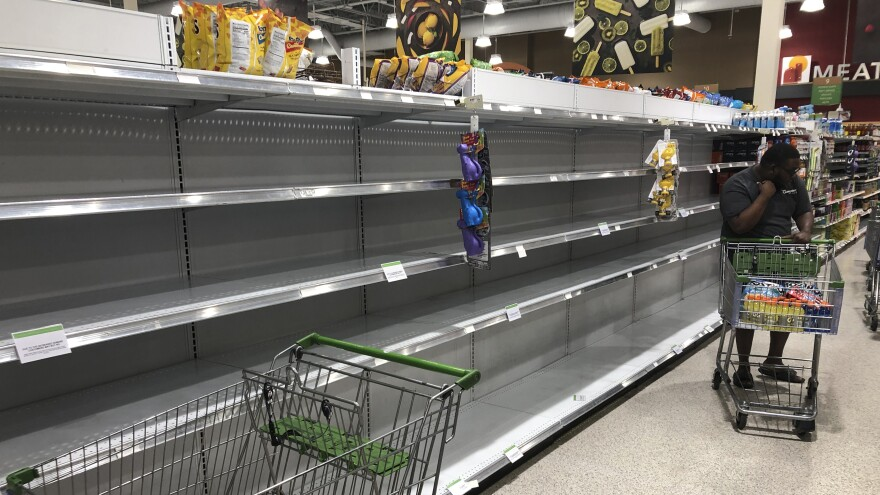 Water was sold out at a grocery store in North Miami, Fla., on Friday as residents heeded warnings to stockpile a week's worth of food and supplies before Hurricane Dorian arrives on Monday.