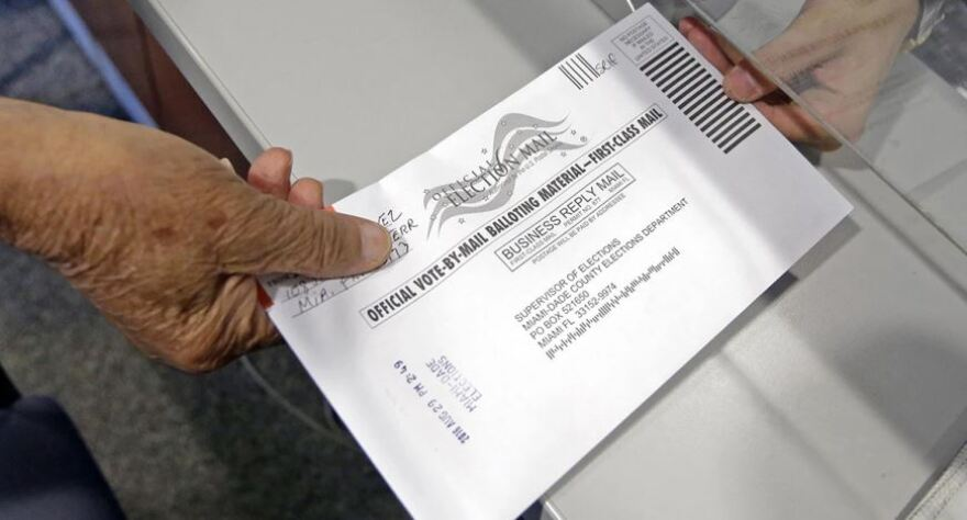 Person handing in a mail-in ballot