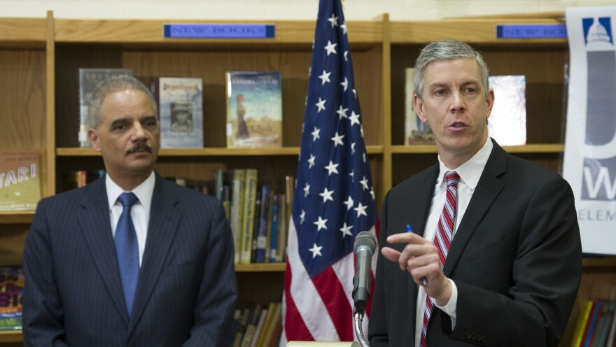 "Education Secretary Arne Duncan, right, and Attorney General Eric Holder, appeared at a Washington, D.C., elementary school and said schools need to reduce ""unnecessary and unfair school discipline practices and other barriers to equity and opportunity at all levels of education."""