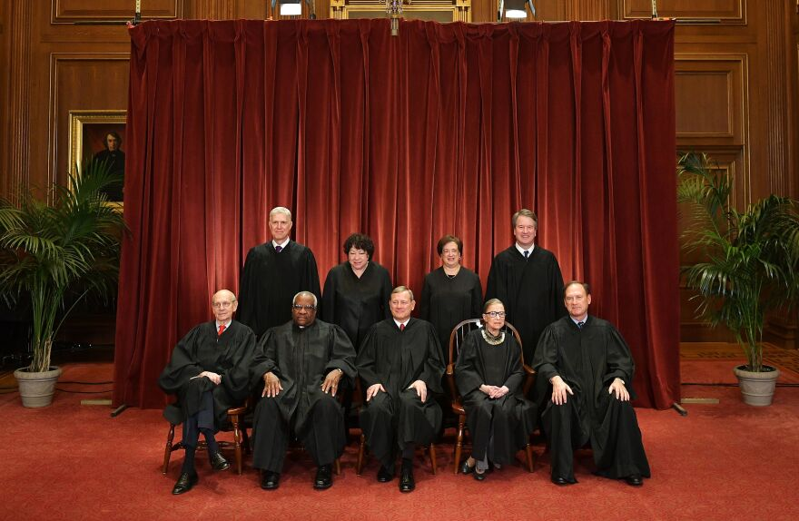 Justices of the U.S. Supreme Court pose for their official photo at the Supreme Court in November 2018. Seated from left: Stephen Breyer, Clarence Thomas, Chief Justice John Roberts, Ruth Bader Ginsburg and Samuel Alito. Standing from left: Neil Gorsuch, Sonia Sotomayor, Elena Kagan and Brett Kavanaugh.